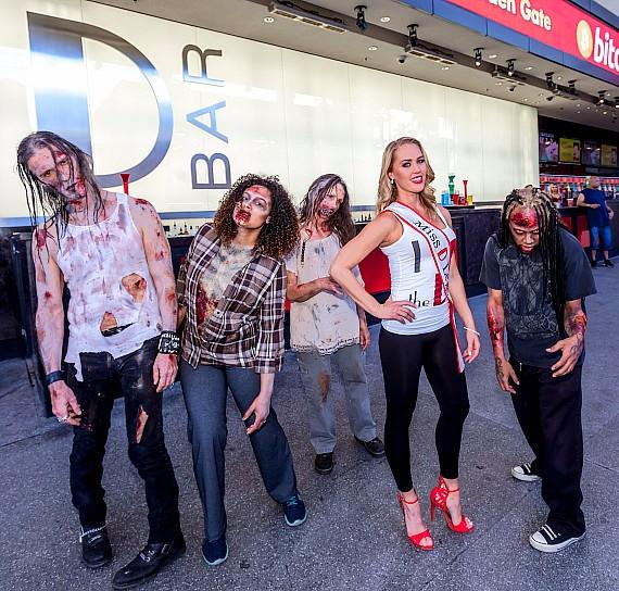 "The D Casino's ""Miss D Legs"" runner up Ruthie with infected from ""Fear The Walking Dead: Survival"" on Fremont Street Experience Las Vegas"