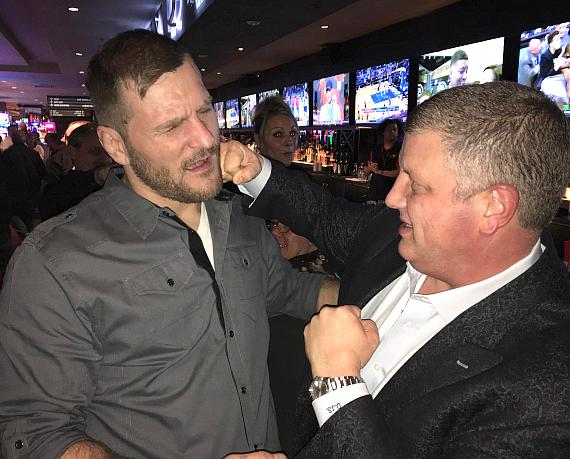 "UFC Heavyweight Stipe Miocic with the D Las Vegas owner Derek Stevens ""throwing a punch"" while at The Longbar inside the D Las Vegas"