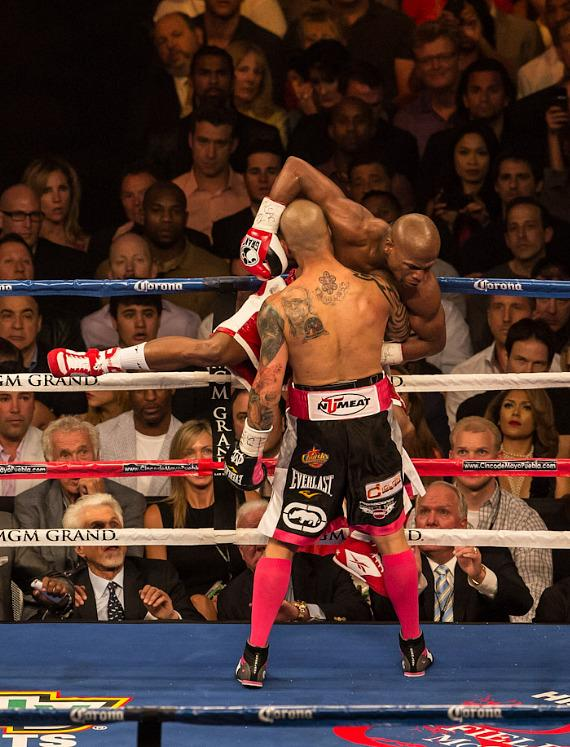 Cotto lifts Mayweather off the mat early in the fight