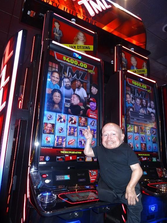 Actor Verne Troyer poses with the popular TMZ Slot Machine at the D Casino Hotel in Las Vegas
