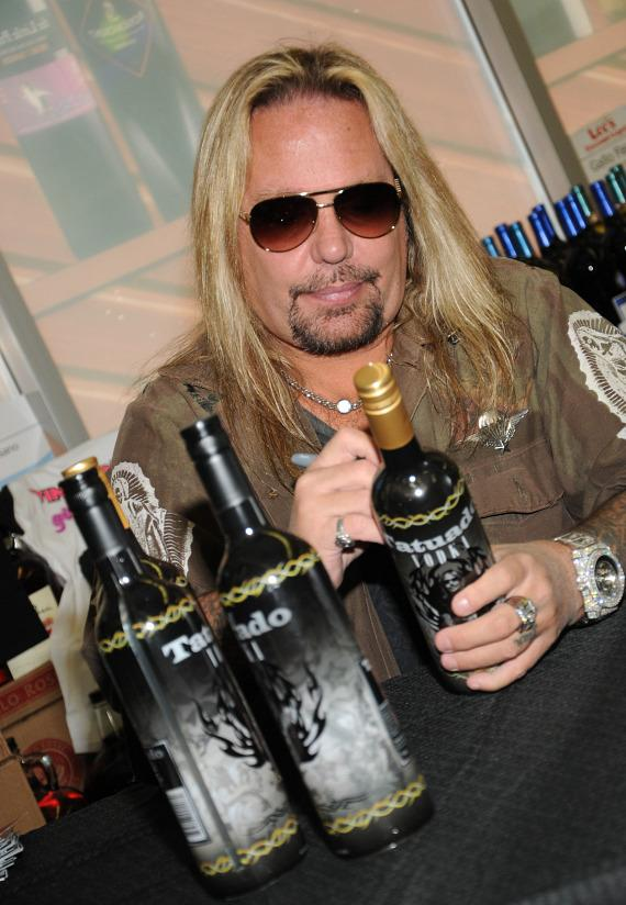 Vince Neil autographs bottles of Tatuado vodka at Lee's Discount Liquor
