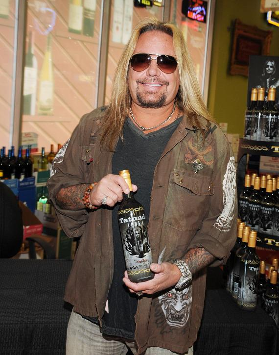 Vince Neil with bottle of Tatuado vodka at Lee's Discount Liquor