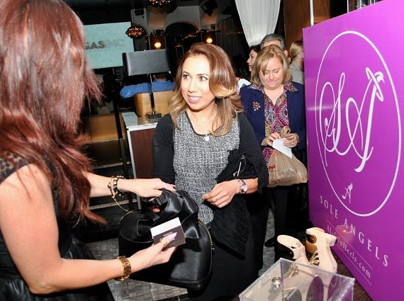 Guest donates shoes to Sole Angels during VEGAS INC's Women to Watch event at Hyde Bellagio