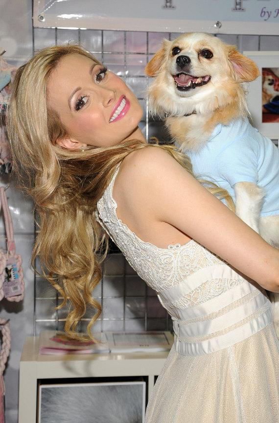 """Holly Madison"""" with her dog Louis at SuperZoo 2012 Convention at Mandalay Bay"""