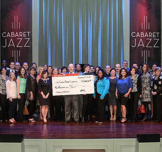 75-plus Southern Nevada community nonprofits post with George W. Smith of Bank of America holding $2 Million check