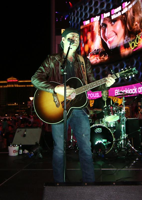 Shane Lee performs on patio stage