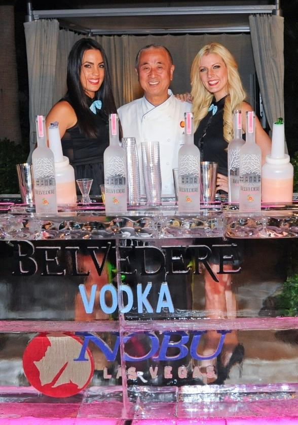 Chef Nobu Matsuhisa poses behind Belvedere bar with Angelica Lopez and Abby Galloway