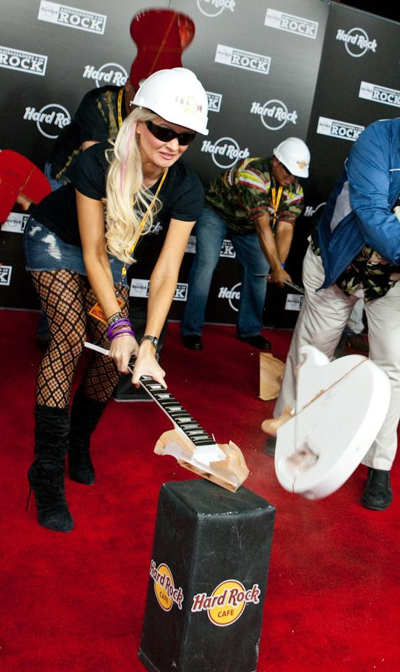 Holly Madison smashes a guitar