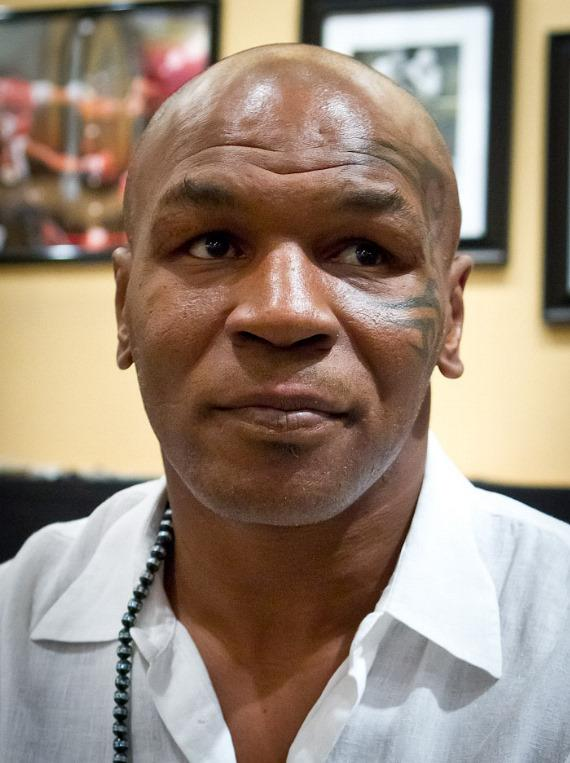 Mike Tyson signs autographs at Painted With Oil at Miracle Mile Shops