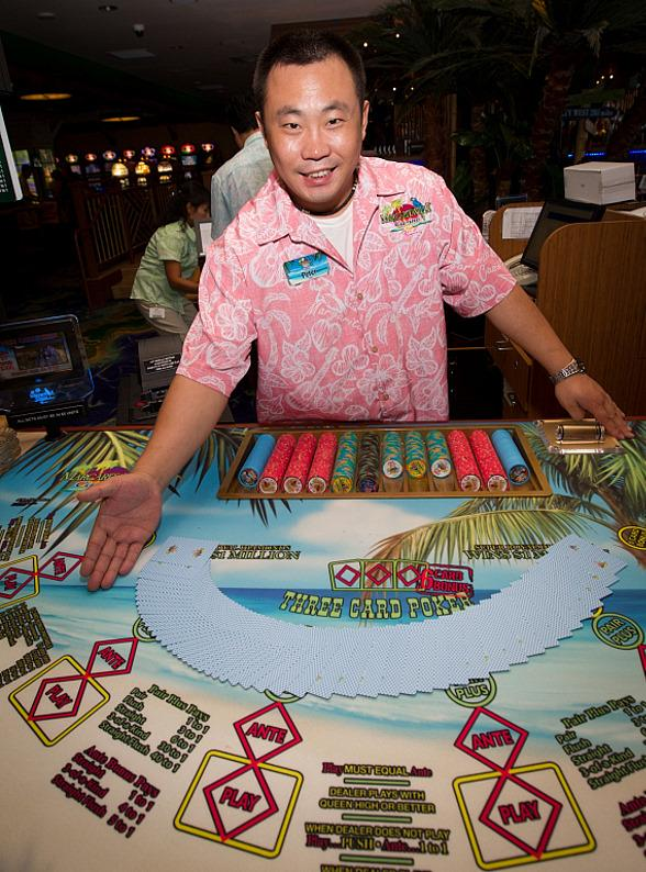 Margaritaville Casino dealer Peter welcomes you to a game of Three Card Poker
