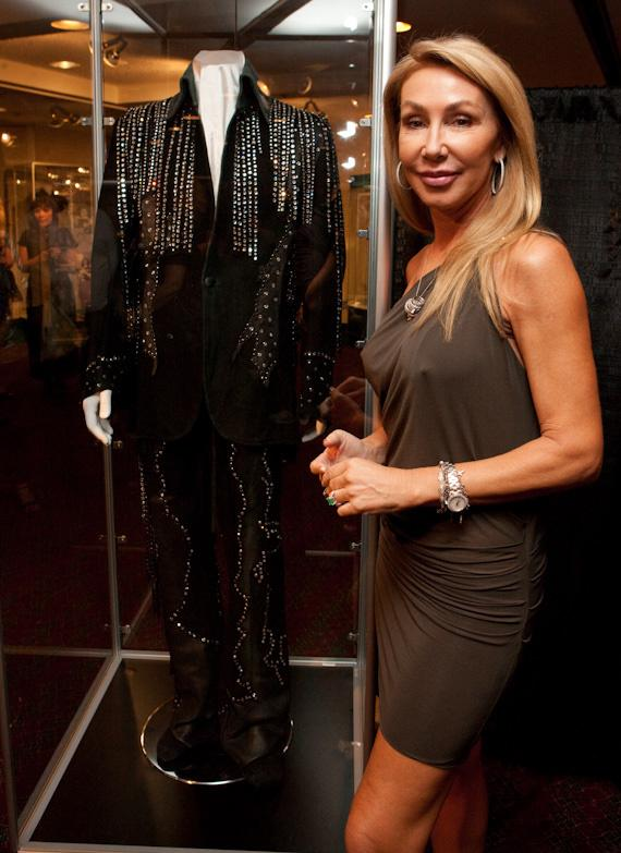 Linda Thompson (Elvis's former girlfriend & Brody Jenner's Mother) by a suit she had deigned for Elvis (apprx. 1974) to match one of her own