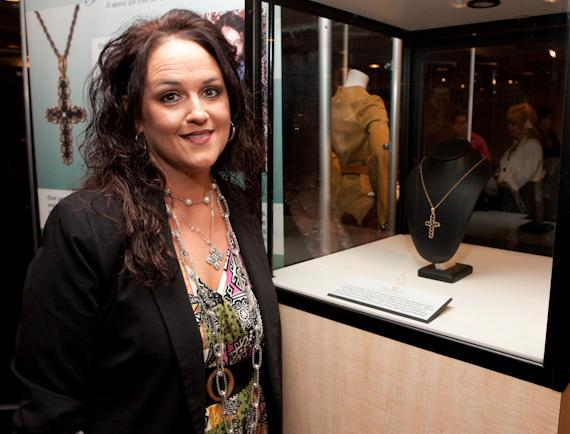Rhonda Williams at the Exhibit by the Cross necklace Elvis took off his neck at a concert in 1974 and placed around her neck when she was 5