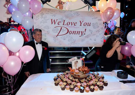 A welcome banner and huge pile of cupcakes await Donny at The Flamingo