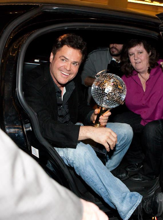 Donny Osmond emerges from the limo with his Dancing With The Stars trophy