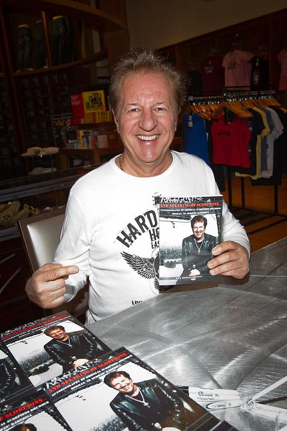 "Herman Rarebell with his book ""And Speaking of Scorpions"" in the Hard Rock Store"