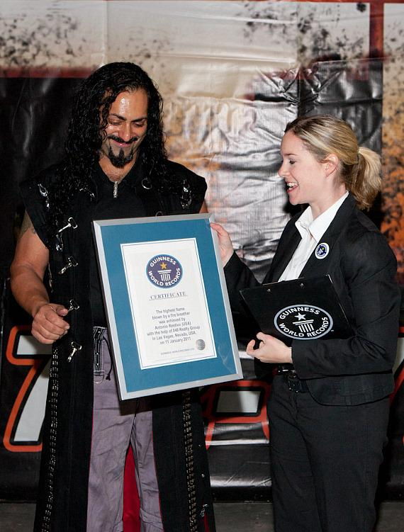 Antonio Restivo receives world record award from Amanda Mochan of Guinness World Records