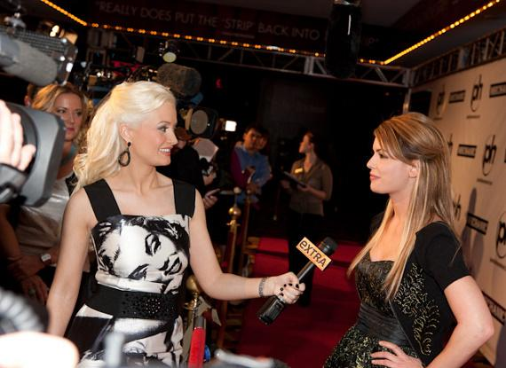Holly makes her TV debut as EXTRA correspondent by interviewing Laura Croft at Planet Hollywood