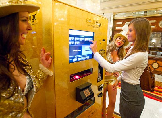 Gold Showgirls and customer at GOLD to Go ATM