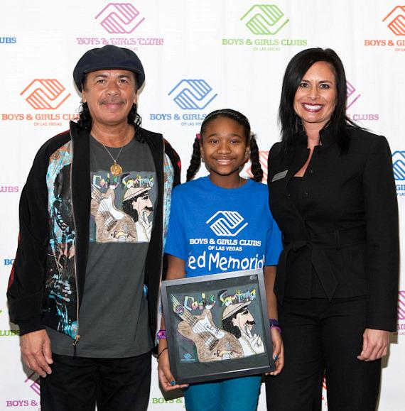 Carlos Santana with Imani and Dulcinea Almazan, President/CEO of Boys & Girls Clubs of Las Vegas