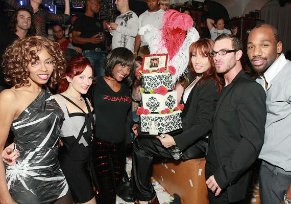 "(front row with cake, L to R) Paris Red (singer), Julia Kolosova (""Hoops""), Bolormaa Zorigtkhuyag (""Water Bowl"" act), Candi Kirtz (dancer), Willie Hulett (""Rose Boy""), Agnes Roux (dancer), Renee Pugh (dancer)"