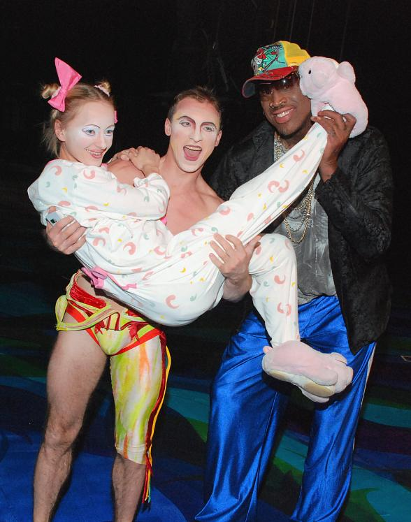 "Dennis Rodman with the ""Baby Girl"" and a Highbar Artist from Mystère by Cirque du Soleil at Treasure Island Las Vegas"