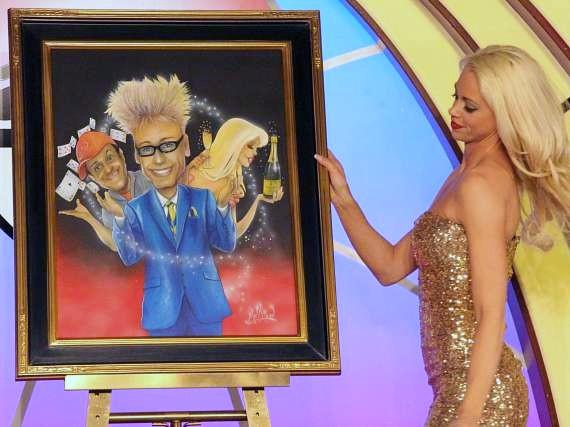 Chloe Louise Crawford admires Jimmy Mulligan's painting of the cast