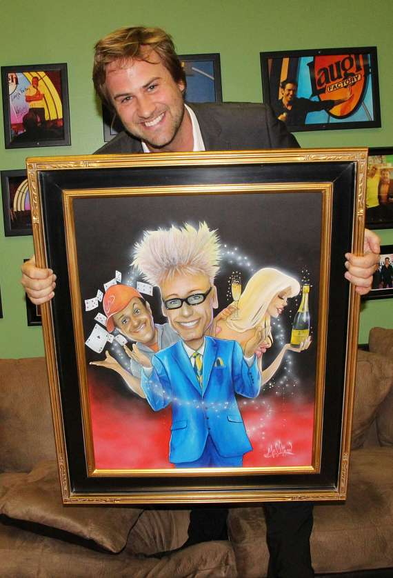 Jimmy Mulligan with his painting of Murray, Lefty and Chloe at The Laugh Factory in Tropicana Hotel & Casino