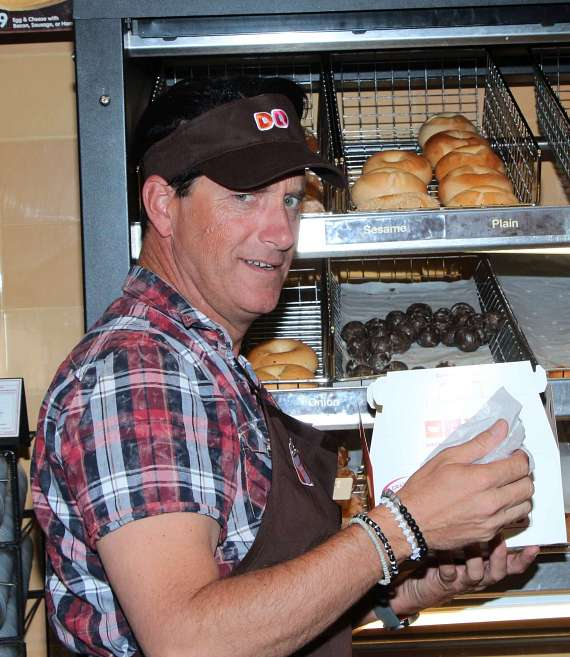Hypnotist Anthony Cools at Dunkin' Donuts during benefit for Nevada Childhood Cancer Foundation