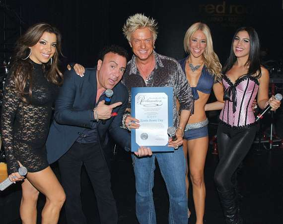"Chris Phillips receives official proclamation of ""Zowie Bowie Day"" from Frankie Scinta"