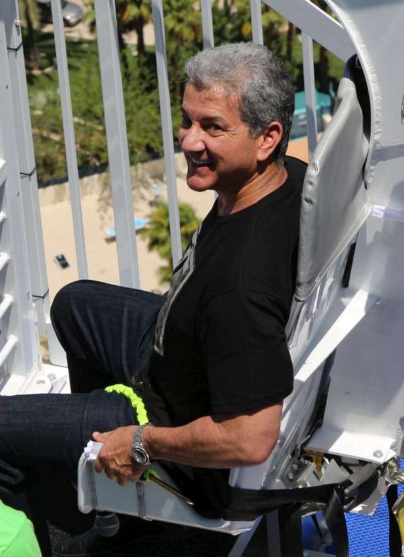 Bruce Buffer is strapped in a ready tp ride the VooDoo Zip Line at The Rio