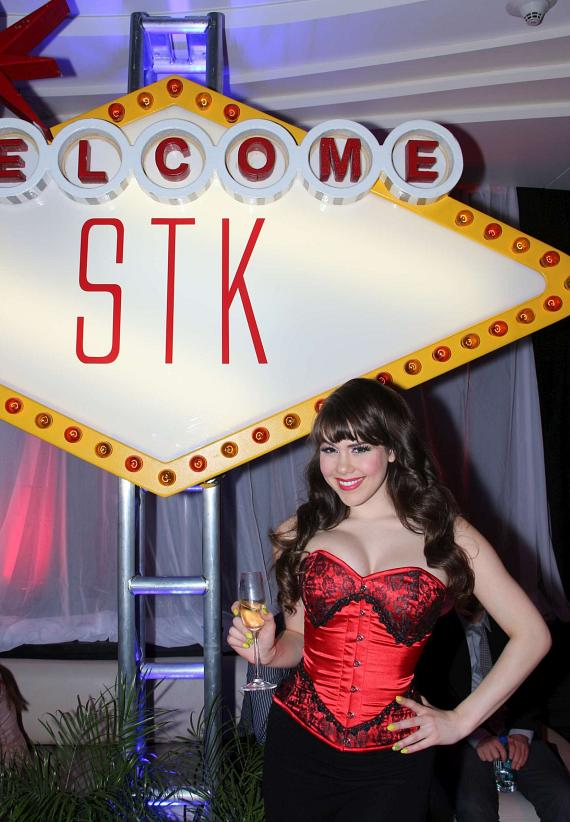 "Claire Sinclair with ""Welcome to STK"" sign"