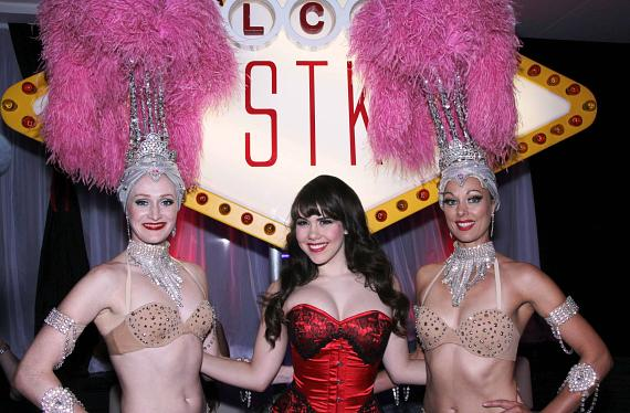 "Claire Sinclair and Showgirls at ""Welcome to STK"" sign"