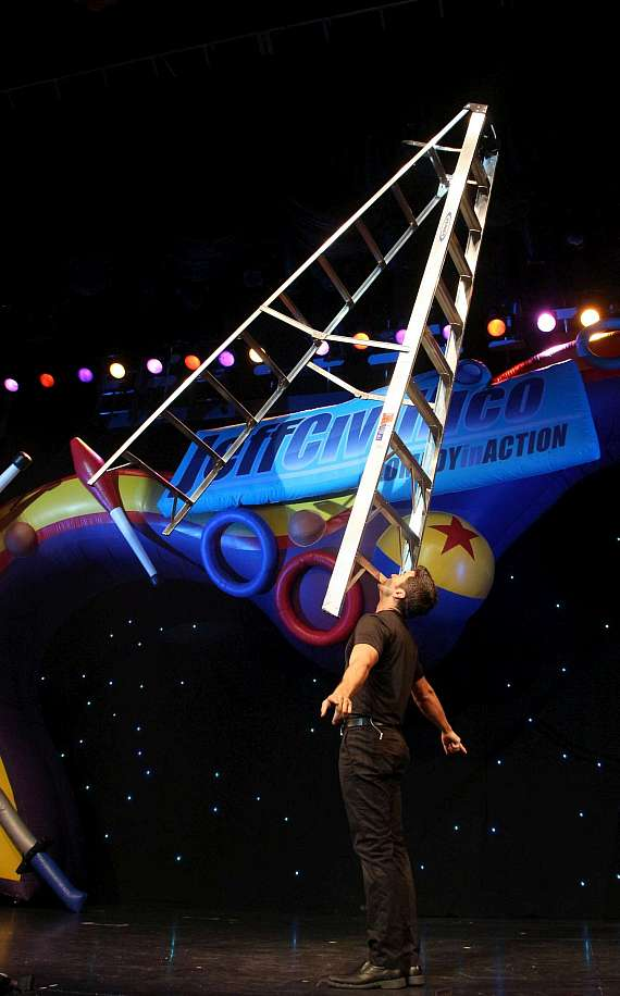 Jeff Civillico balances a step ladder on his chin