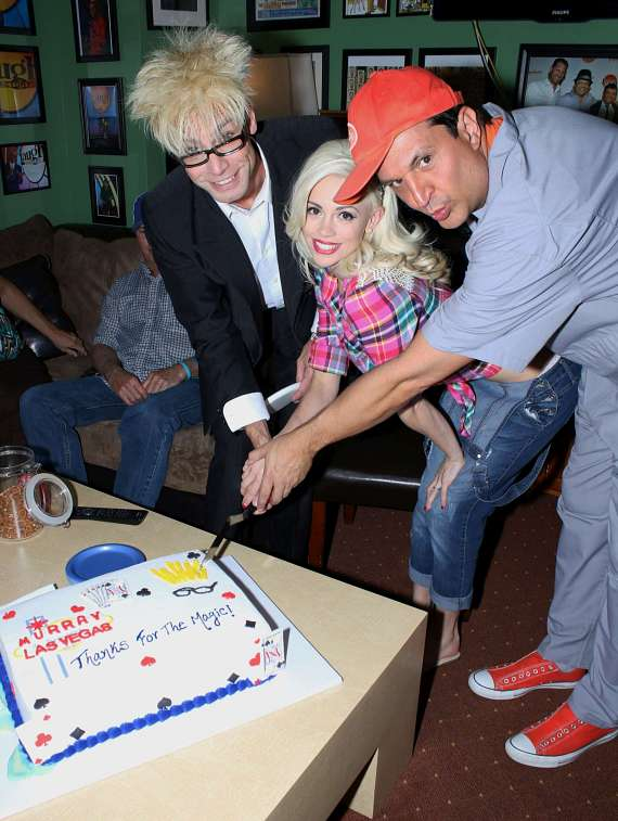 Murray, Chloe & Lefty cut a congratulatory cake at The Laugh Factory