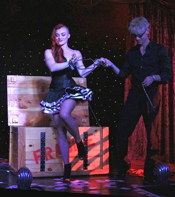 "April Leopardi Anneberg and Murray SawChuck perform in ""MURRAY 'Celebrity Magician'"" at Planet Hollywood in Las Vegas"