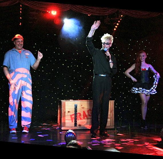 "Douglas ""Lefty"" Leferovich, April Leopardi Anneberg and Murray Sawchuck perform in ""MURRAY 'Celebrity Magician'"" at Planet Hollywood in Las Vegas"
