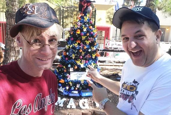 "Murray SawChuck and Douglas ""Lefty"" Leferovich with Christmas tree at Opportunity Village"