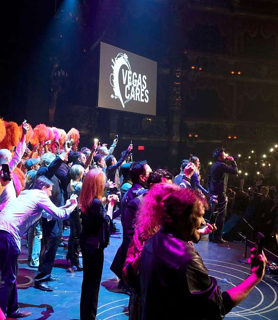 "Cast of ""Vegas Cares"" joins Elvis Monroe on stage"