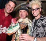 Murray-Sawchuck-poses-with-guests-at-his-shrunken-head-reveal-unsmushed