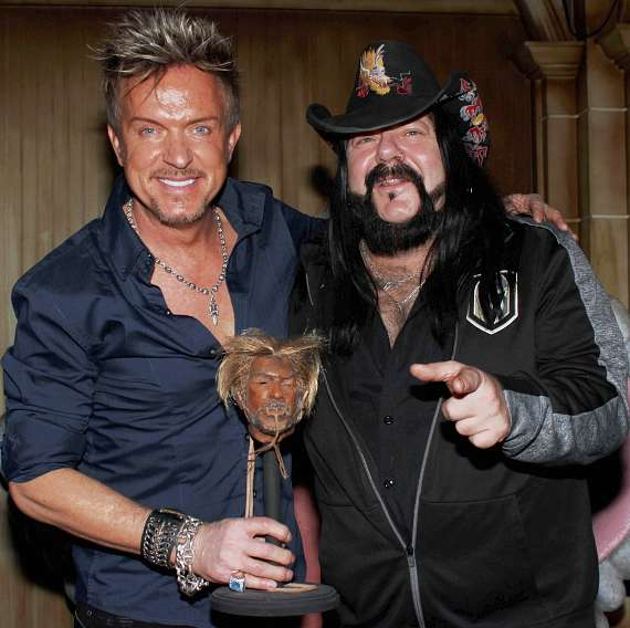 Chris Phillips of Zowie Bowie with Vinnie Paul at The Golden Tiki in Las Vegas