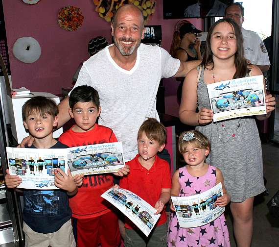 """Tanked"" star and Donut Mania owner Brett Raymer with young fans"