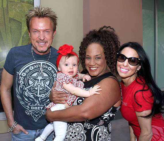Chris Phillips, Michelle Johnson (holding Chris and Jennifer's baby) and Jennifer Lynne Phillips
