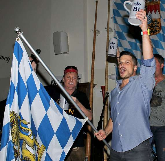 Mark Shunock waves the Hofbräuhaus flag to celebrate the tapping of  Oktoberfestbier beer at Hofbräuhaus Las Vegas