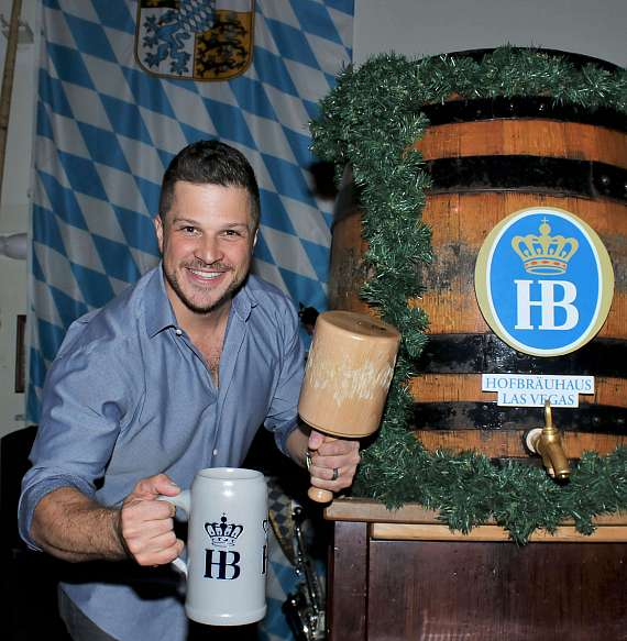 Mark Shunock poses with the mallet and mug after successfully tapping a keg of beer at Hofbräuhaus Las Vegas