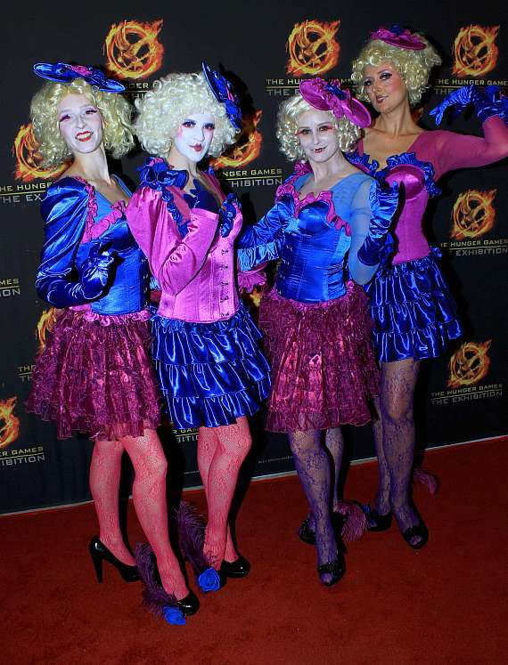 """Models dressed as the character Effie Trinket from """"The Hunger Games"""" movie franchise"""
