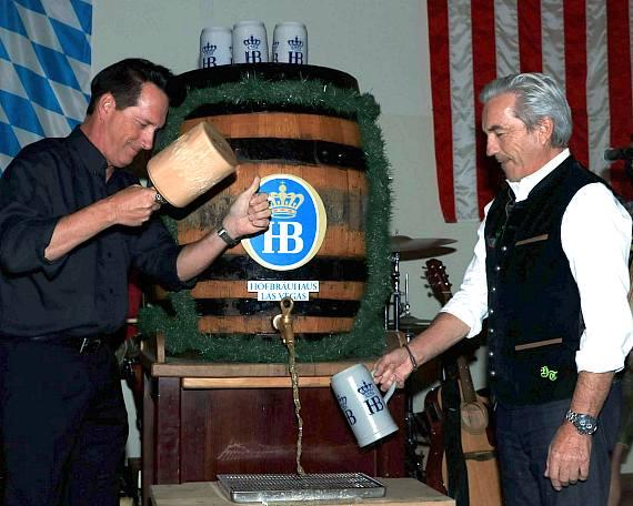 Anthony Cools taps a keg at Hofbräuhaus Las Vegas