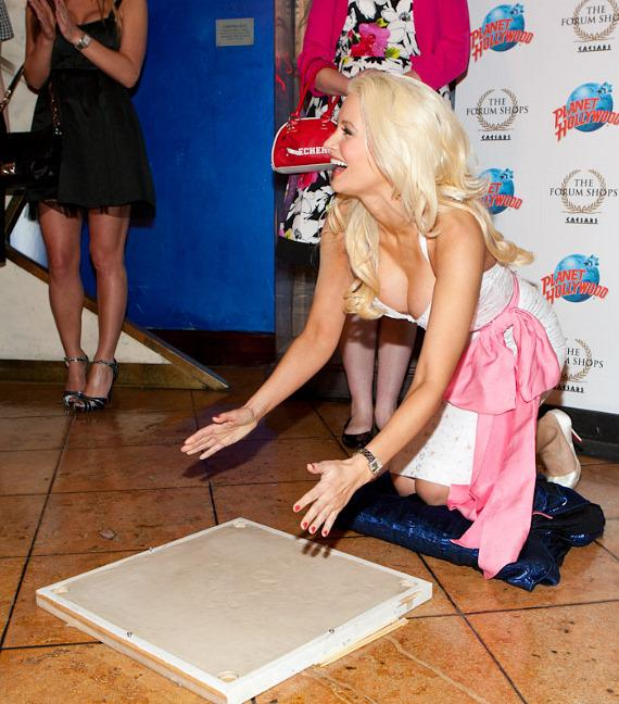 Holly Madison ready to press her hands into the cement at Planet Hollywood