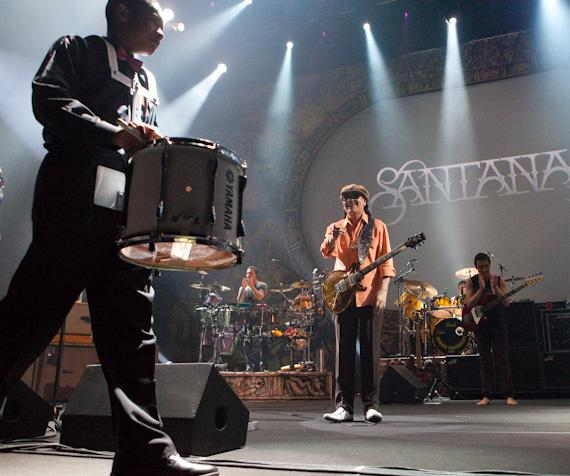 Carlos Santana performs with Andre Agassi Prep Academy Drum Line