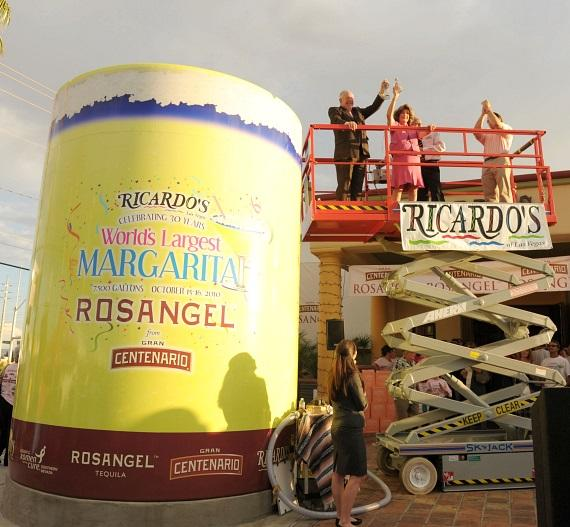 "Mayor Oscar B. Goodman and Congresswoman Shelley Berkley, pouring in the final ROSANGEL Tequila into the 14 foot tall, 10 foot wide tank to break the Guinness World Record at 7,627 gallons for the ""World's Largest Margarita""."