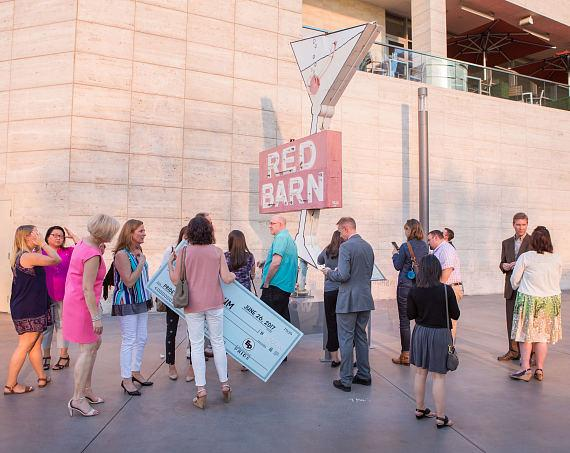 LGBTQ Advocacy Group Executive Pride Presents Neon Museum with $2,500 in Front of Red Barn Sign at Fashion Show Plaza Las Vegas